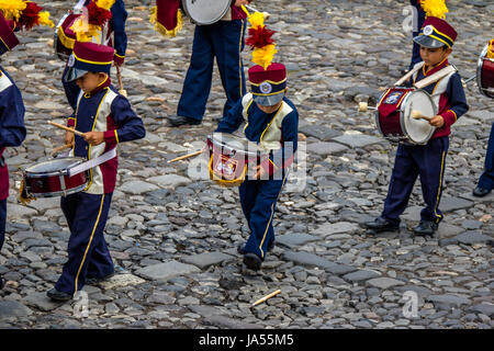 ANTIGUA, GUATEMALA - Sep 4, 2016: Group of small kids Marching Band in Uniforms - Antigua, Guatemala - Stock Photo