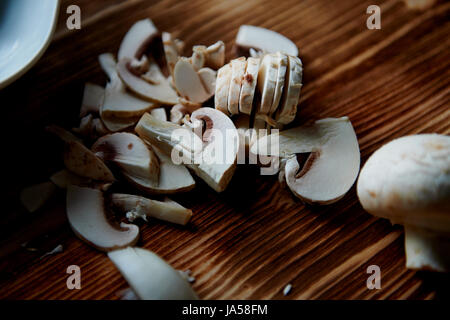 The process of cooking. mushrooms whole and sliced - Stock Photo