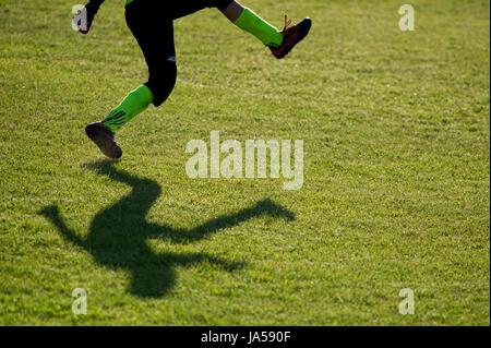 Shadows of young football players. Gdansk, Poland © Wojciech Strozyk / Alamy Stock Photo - Stock Photo
