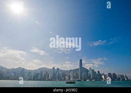 Horizontal view of the infamous skyscrapers making up the Hong Kong skyline on a sunny day. - Stock Photo