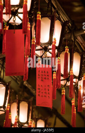 Vertical view of prayers tied to decorative lanterns inside the Man Mo temple in Hong Kong, China. - Stock Photo