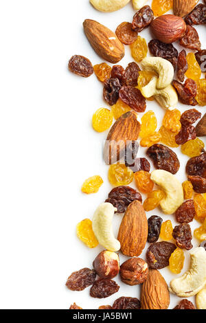 Various nuts and raisins isolated on white background. - Stock Photo