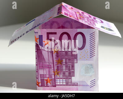 A house bulit from 500 Euro bills, symbol of building a house and paying mortgage - Stock Photo