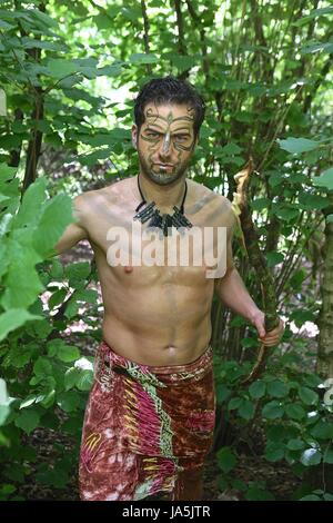 Tribal shoot a shoot showing the styles in Borneo from the tribal people modeled by Western Models shoot done in - Stock Photo
