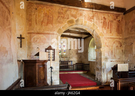Medieval wall paintings in St Botolph's church in Hardham village, West Sussex, England. - Stock Photo