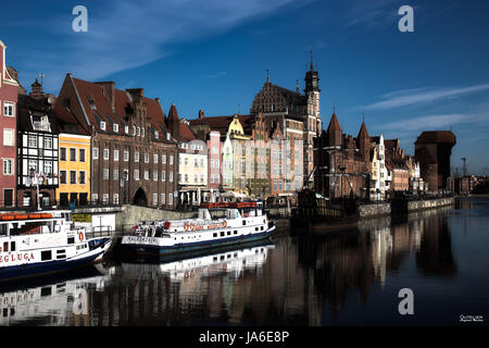 Gdansk, Danzig an old medieval polish and german city, the old town. View on sunny day with blue sky from the river - Stock Photo
