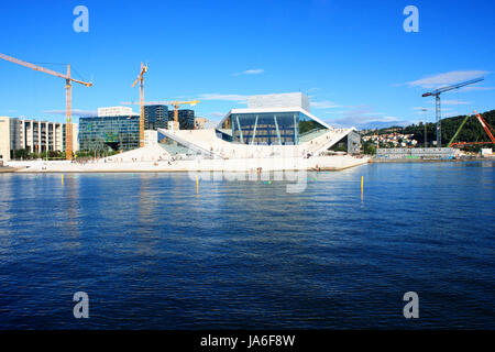 OSLO, NORWAY AUGUST 17, 2016: Tourist on the Oslo Opera House which is home of Norwegian National Opera and Ballet - Stock Photo