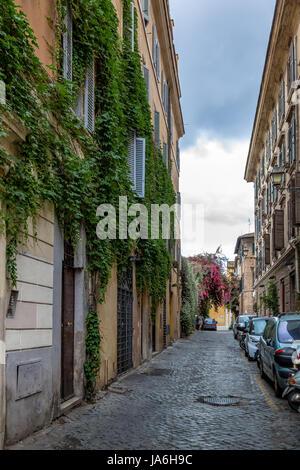 Narrow old street in Trastevere - Rome, Italy - Stock Photo