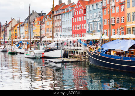 COPENHAGEN - SEPTEMBER, 10: Nyhavn is a 17th century waterfront, canal and entertainment district. It was constructed - Stock Photo