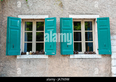 The old window with shutters in the wall of an ancient house. Towm on Lake Garda is the largest in Italy. It is - Stock Photo