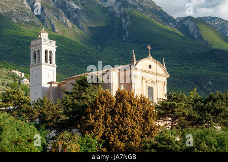 Parish church of Santo Stefano in Malcesine, Summer morning on Lake Garda. Italy, Europe. It is located in NorthernItaly. - Stock Photo
