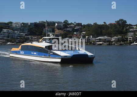 Brisbane, Australia: CityCat passenger ferry approaching New Farm Wharf on the Brisbane River - Stock Photo