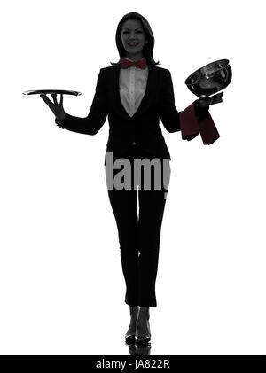 one caucasian woman waiter butler opening catering dome in silhouette  on white background - Stock Photo
