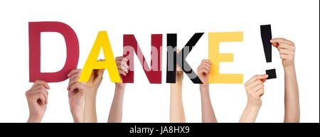 People Holding the German Word Danke Which Means Thanks in the Colors of Germany, Isolated - Stock Photo