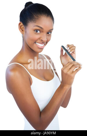 Woman using nail file on white background - Stock Photo