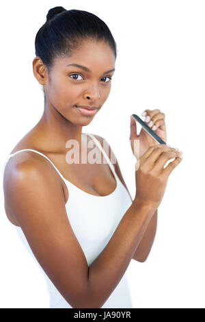 Young woman using nail file on white background - Stock Photo