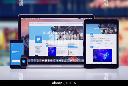 Twitter on the Apple iPhone 7 iPad Pro Apple Watch and Macbook Pro - Stock Photo