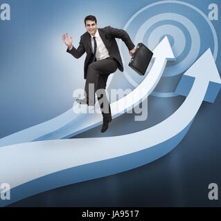 Businessman jumping over blue arrows on the background - Stock Photo