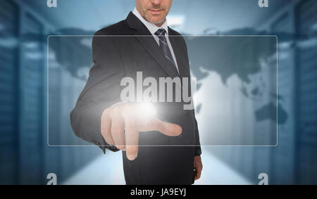 Businessman touching panel with world map on background in data center - Stock Photo