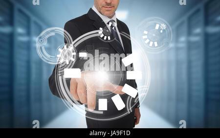 Businessman using circle interface in data center - Stock Photo
