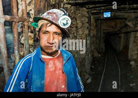 Potosi, Bolivia - November 29, 2013: One miner at the entrance of the silver mine of the Cerro Rico in Potosi, Bolivia. - Stock Photo