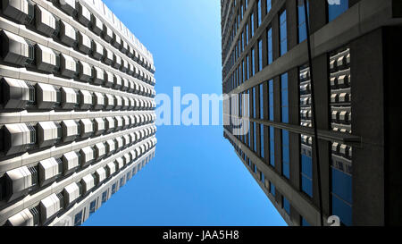 This is an image of two buildings looking up located in San Francisco's financial district. - Stock Photo