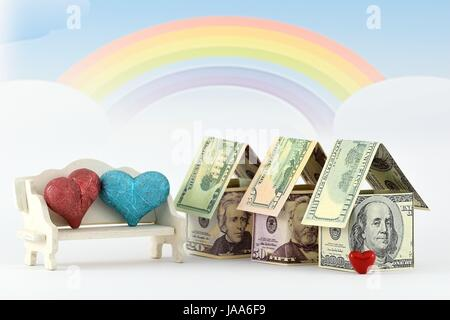 Real Estate Trading. Material: banknotes (dollars), small hearts, furniture miniature and rainbow background. - Stock Photo
