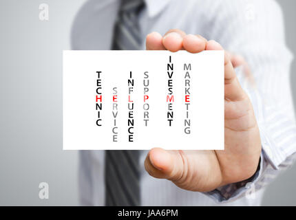 Businessman holding a card with the words Help Me - Stock Photo