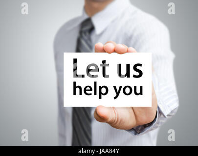 Businessman showing card with Let us help you text - Stock Photo