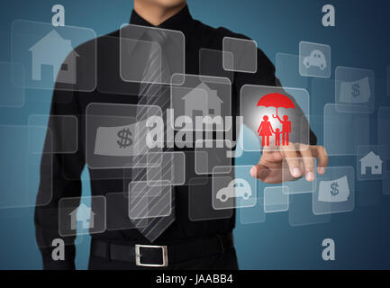 Businessman pressing insurance button on virtual screens, internet and networking concept - Stock Photo