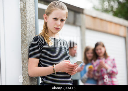 Pre Teen Girl Being Bullied By Text Message - Stock Photo