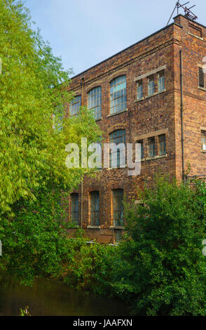 Old carpet warehouse next to the river Stour, Kidderminster, Worcestershire, England, Europe - Stock Photo