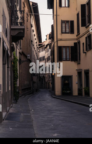 Narrow street and buildings near the River in Florence Italy, at dawn. - Stock Photo