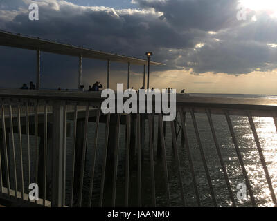 Storm clouds over pier in Coney Island - Stock Photo