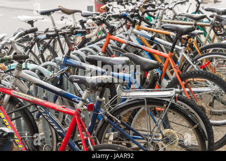 Montreal, Canada - 03 June 2017: Close up of parked bicycles at Place Gérald-Godin - Stock Photo
