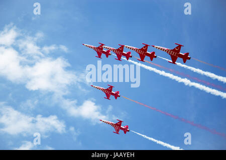 The Turkish Stars, an acrobatic team, jet formation, by the airshow in Poznan, Poland, Ławica Airport. - Stock Photo