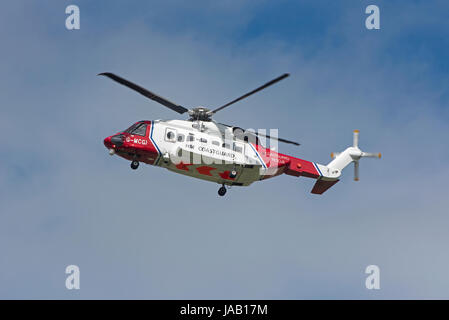 Coastguard helicopter departing from home base at Inverness Airport on an emergency call out. - Stock Photo
