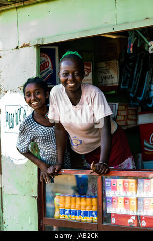 Shop assistands in small shop, Arba Minch, Ethiopia - Stock Photo