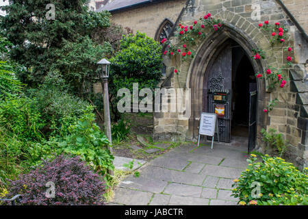 The entrance to St Bene't's Church in Cambridge - Stock Photo