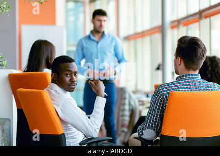 business, startup, presentation, strategy and people concept - man making presentation to creative team at office - Stock Photo