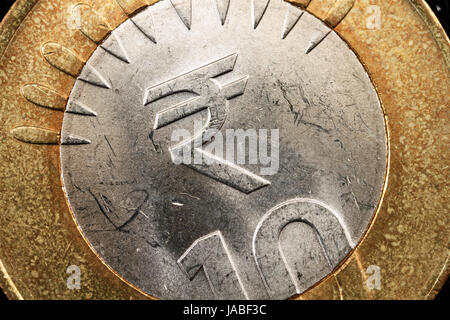 Super Macro Of An Indian Rupee Symbol On A Coin Stock Photo