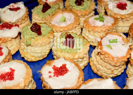 voulevant stuffed with various creams - Stock Photo