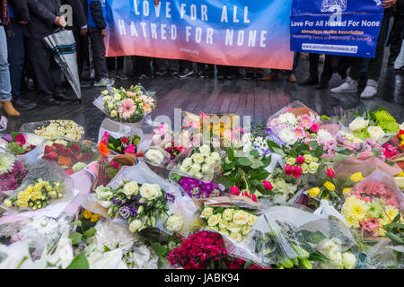 Flowers at the vigil outside City Hall in memory of those who lost their lives and were injured during the attacks - Stock Photo