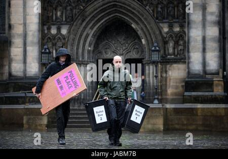 Election staff from City of Edinburgh Council deliver signage and ballot boxes to a polling station ahead of Thursday's - Stock Photo