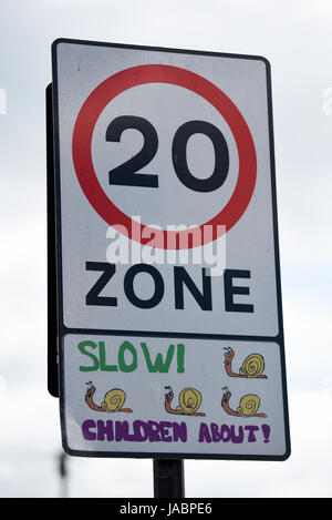 20mph speed limit zone sign with snails, slow, children about. Urban traffic calming. Space for copy - Stock Photo