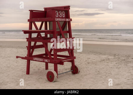 Red Life Guard Stand On A Beach During Golden Hour - Stock Photo