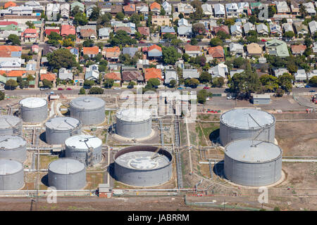 Industrial plant in residential area. - Stock Photo