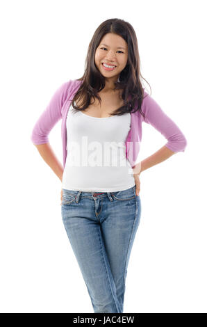 Portrait of Asian girl smiling and standing isolated over white background. - Stock Photo