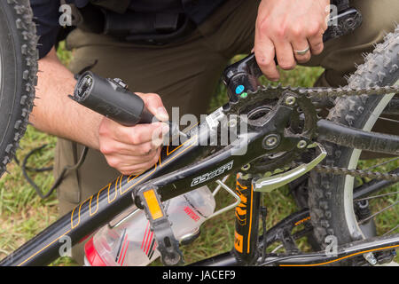 Montreal, Canada - 4 June 2017: A police officer is engraving a bike with an ID number at Park Jeanne to reduce - Stock Photo