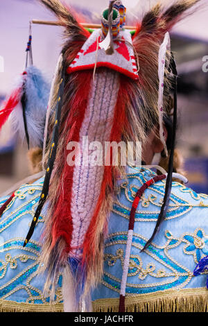 Close up of a beaded, feathered and woven headdress at a pow wow in Montana. Photographed from the back. - Stock Photo